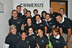 Students posing outside Conexus' offices