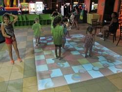 Kids having fun on the interactive floor