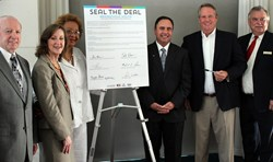 "Shreveport and Bossier Mayors, Stacy Brown, Sam Voisin, Talty O'Connor and Mike Green ""seal the deal"" for the Rendezvous South tradeshow."