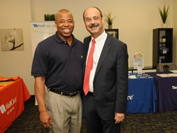 Sen. Eric Adams joins Dr. Richard Petrucci, state medical director, WellCare of New York, at the Healthy Ways With WellCare wellness program kick-off in Brooklyn on July 26, 2013.