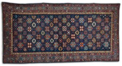 Antique Caucasian Shirvan circa 1920s. Shirvan is situated in the Caucuses - this carpet is finely knotted using 100% natural vegetable dyes in vivid reds, blues, gold, brown and green in all over Star design
