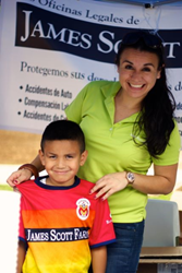 James Scott Farrin's employee Daniela posing with little fan at the 9th Annual Ritmo Latino Festival by Diamante Inc. in Cary, NC