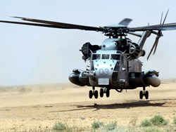 U.S. Marine Corps CH-53 Sea Stallion landing on Durasoil treated desert blow sand eliminating any dust and FOD