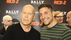 Arthur Kade interviewing Bruce Willis at Red 2 premiere