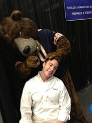 Cliff Carey, communications director for EarQ, gets his ears inspected by Staley Da Bear