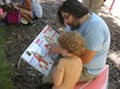 Parent and Child read anatomy books in Colfax