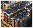 Solar water heating saves apartment owners money.