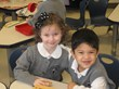Isabelle, daughter of Joe & Margaret Collecchia of Lockport, and Jonas, son of Edgar and Marcia Sarmiento, of Willow Springs look foward to full day PreK 4 at Everest Academy