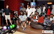 NY GIANTS take a football pause to play a game of bowling