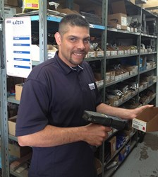 Jason Farley, Trailer Wizards' Parts Manager (Québec Region), checks inventory in Montréal's Parts Department.