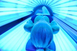 tanning bed image with woman