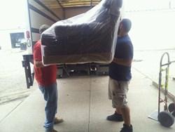 Unloading Charles Schneider furniture