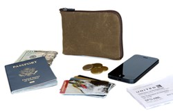 The Passport Wallet—Tan Waxed Canvas version shown with potential contents