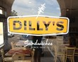 Image of Dilly's Deli logo on window.