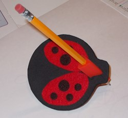 Photo of Doodle Bug, a student designed assistive technology writing device