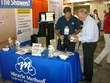 Matt Mozingo of Miracle Method shows color samples to a booth visitor