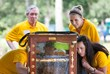 A Peak at the Hive Bayer CropScience volunteers  and external communication manager Greg Coffey  [LEFT] examine a bee exhibit before the event.