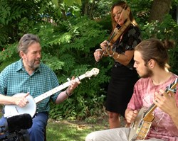 From left: Mike King playing The Shackleton prototype, Hayley Moyses on fiddle, and Solomon Amos playing the Islander Ash Leaf