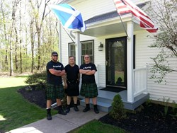Kilted Technicians with a very happy kilted customer!