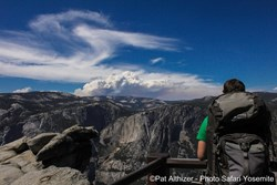 Photo courtesy Pat Althizer: Smoke from the Rim Fire is visible in the distance from Glacier Point in Yosemite Valley. Much of Yosemite remains unaffected by the large blaze burning in the norwesther edge of the park.