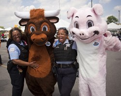The Moo & Oink characters with some of Chicago's finest