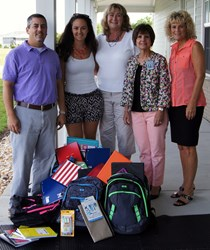 Corolla Classic and Corolla Real Estate staff with the donated school supplies