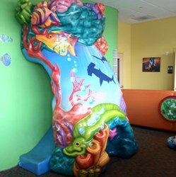Kids Little Smiles dental clinics offer indoor playgrounds to attract customers and entertain patients.