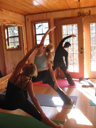 Enjoying yoga practice in yoga studio surrounded by nature