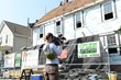 """O'LYN Roofing working on the set of """"Flipping Boston""""."""