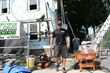 "Danny Essary of O'LYN Roofing working on the set of ""Flipping Boston""."