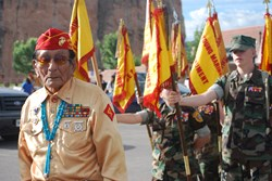 A Navajo Code Talker marches in the parade in front of the Young Marines at Navajo Code Talkers Day in Window Rock, AZ