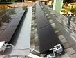 Rack mounted solar panel system installed by Chandler's Roofing in Orange, CA