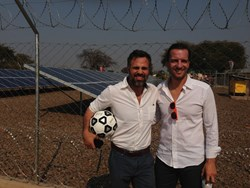 Empowered by Light co-founder Marco Krapels and actor Mark Ruffalo in front of the 24kW solar array at Sioma High School, Zambia.