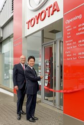 Masanori Nohara, Executive Director and Coordinator, Toyota (GB) PLC and Andrew Grzesinski, Group Managing Director, Macrae & Dick cutting the ribbon at Macrar & Dick Toyota