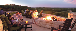 A family spends time together overlooking the Hill Country views of Cordillera Ranch.