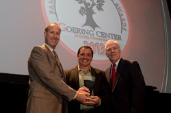 Definity's founder accepts the Goering Center Private Business Award.