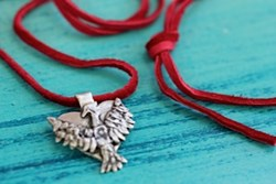 sterling silver with red leather cord