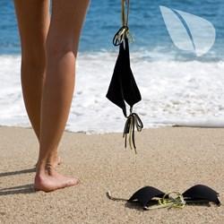 Nudist woman on the beach