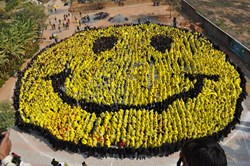 Men In Kilts will attempt to break the World Record for 'Largest Human Smiley' seen here held by India with 3,737 people