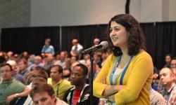 SPIE Optics + Photonics drew an international audience for a week of cross-disciplinary presentations, professional development and an exhibition; above, an audience member steps up to ask a question during the all-symposium plenary session.