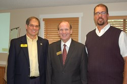 Martin J. (Marty) Rueter, president of Weichert Real Estate Affiliates, Inc. (center) traveled to Olympia from New Jersey headquarters to welcome Broker/Owner Randy Reynolds (left) and Vice President Ryan Reynolds (right) as the agency, now named WEICHERT