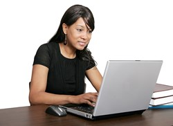 Woman seated at laptop