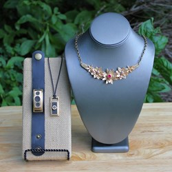 Display Piece featuring Floral Statement Necklace and Men's Pendant/Cuff by Kathryn Designs