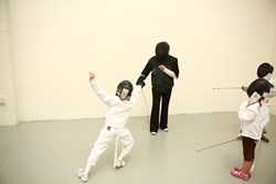 Homeschoolers take a fencing lesson at Academy of Fencing Masters