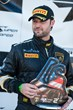 Parris Mullins of Lamborghini Beverly Hills on the winner's podium