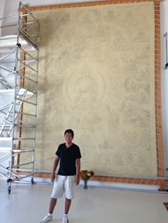 Tashi Dhargyal stands before his Thangbochi (big thangka). Drawing has just been completed. Painting will occupy Tashi for the next five years.