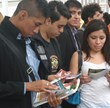 Youth read The Truth About Drugs booklets given to them by Mexico City School Safety Police officers at the July 2013 fair at Zócalo (Constitution Square).