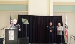 bill howe presents oceanside officer, matt lyons, with award