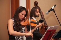 Sabina Rakcheyeva from Azerbaijan playing the violin at the Liberal Democrat Party Conference
