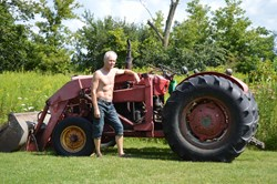Robert Seagrove pauses during chores on his farm three months after surgery for colon cancer.